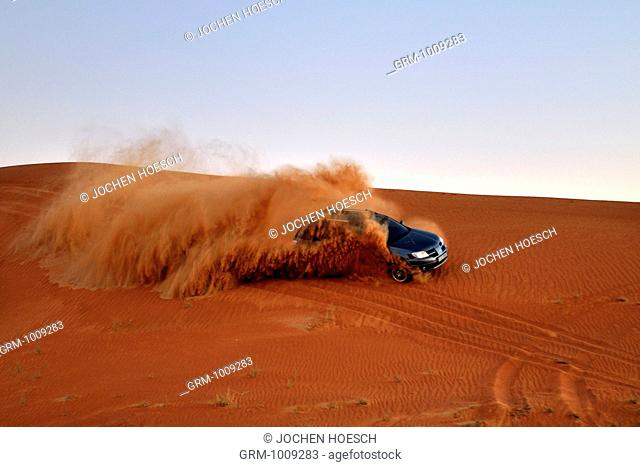 Dune bashing with 4x4 car in the desert near Al Ain, United Arab Emirates