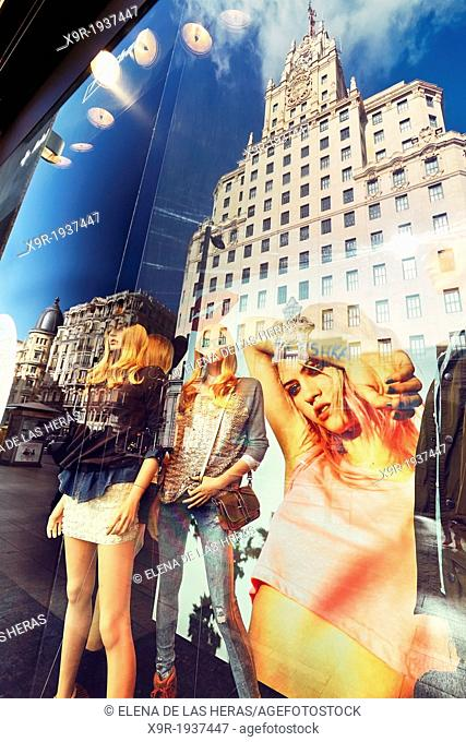 Mannequins and reflections at a window shop in Callao square. Madrid. Spain