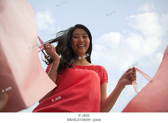 Chinese woman carrying shopping bags