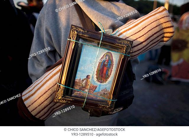 A pilgrim carries on his back an image of the Our Lady of Guadalupe in Mexico City, December 11, 2010  Hundreds of thousands of Mexican pilgrims converged on...