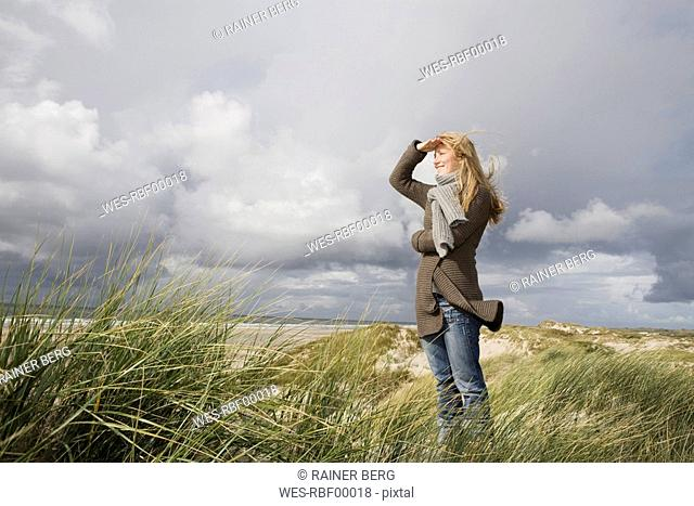 Germany, Schleswig Holstein, Amrum, Woman Looking out to Sea