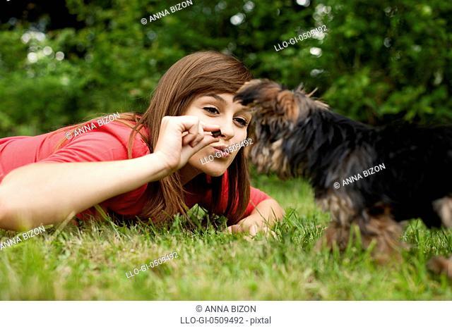 Woman feeding puppy Debica, Poland