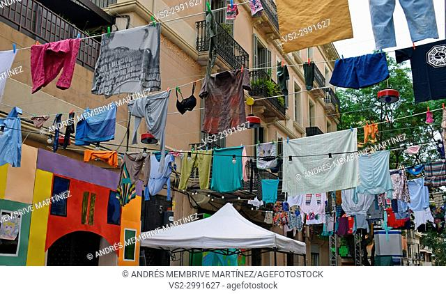 Clotheslines in a decorated street. Festes de Gracia (Gracia district festival). Barcelona. Spain