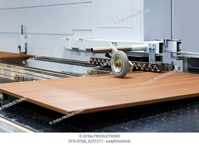 wooden board on conveyer at furniture factory
