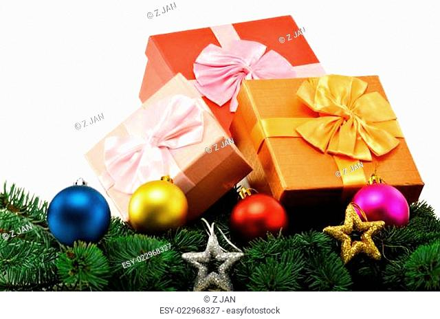 Colorful gift boxes and christmas tree isolated on white