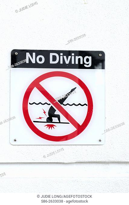 Sign Posted Near a Swimming Pool