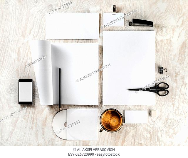 Photo of blank stationery and corporate identity set on light wooden background. For design presentations and portfolios