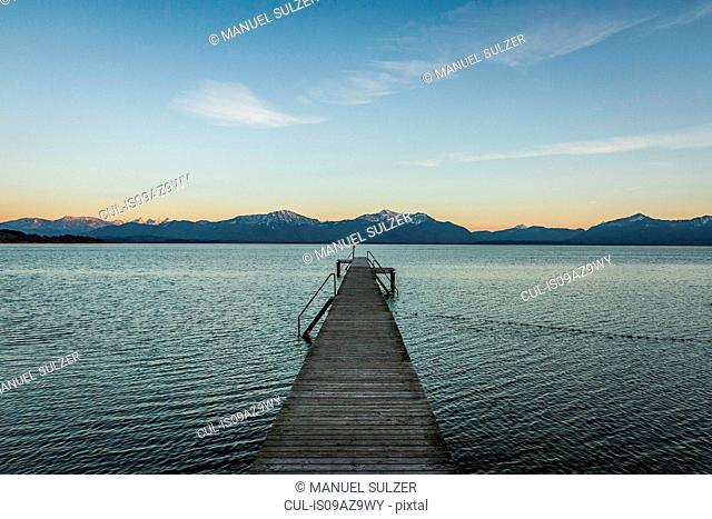 Wooden pier with view of mountains, Rosenheim, Bavaria, Germany
