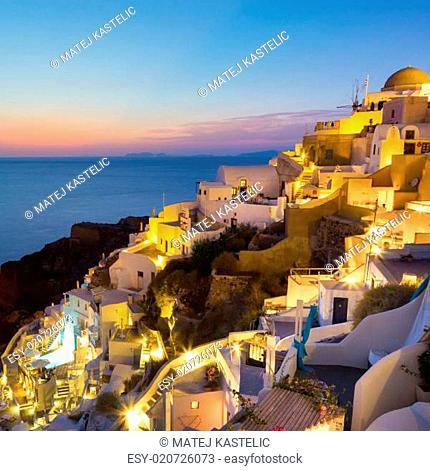 Oia village on Santorini in sunset, Greece