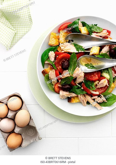 Bowl of fish with vegetables and eggs