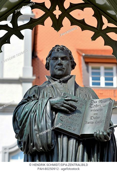 The Martin Luther statue on the marketplace in front the city hall in Wittenberg (Saxony-Anhalt), Germany, 20 April 2016