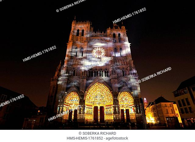 France, Somme, Amiens, Notre Dame Cathedral of Amiens listed as World Heritage by UNESCO, polychromatic illumination and color rendering of the facade of the...
