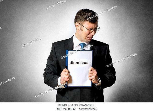 Image of frustrated business man who is fired