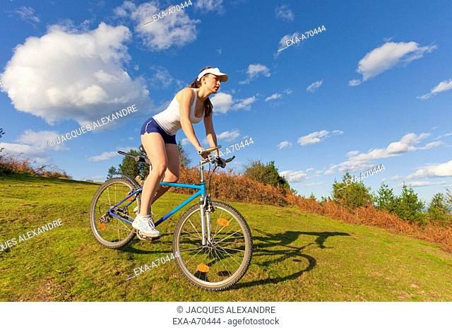 Woman driving bike in mountains