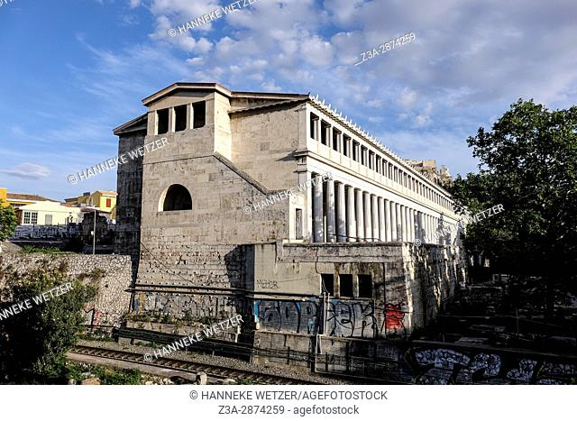 Ancient building in Athens, Greece, next to a railway
