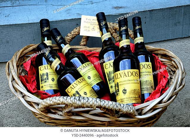 basket with bottles of Calvados, Honfleur, Calvados, Normandy, France