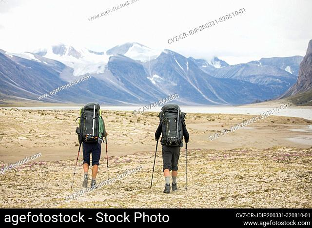 Two backpackers hiking in Auyuittuq National Park, Canada