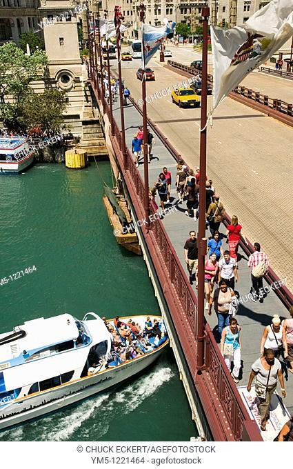Architectural Cruise Ship going under Michigan Avenue Bridge at the Chicago River