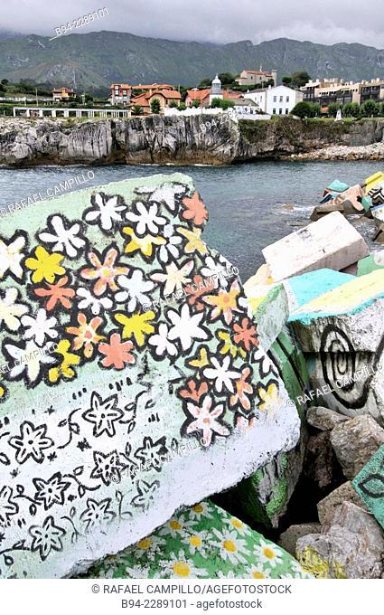 'Los Cubos de la Memoria' the cubes of memory, work by sculptor Agustin Ibarrola in the seaport. Llanes village. Principality of Asturias. Spain