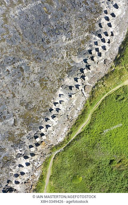 Aerial view of Second World War era anti-tank blocks on shore at Gosford Sands at Longiddry in East Lothian, Scotland, UK
