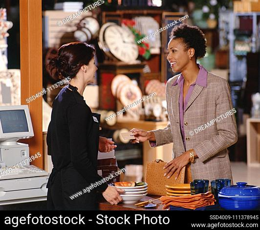 Woman paying for household goods
