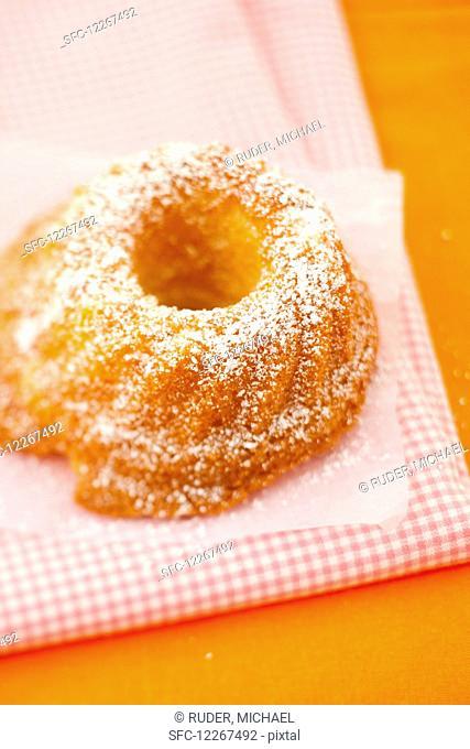 A small guglhupf with icing sugar
