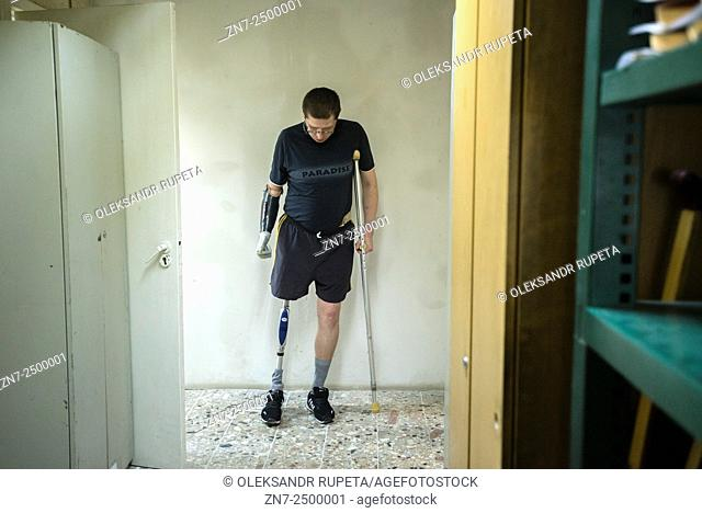 Ukrainian soldier, who lost his arm and a leg during fighting near Illovaisk in the Donetsk region last August, learns to walk with his new bionic leg during...