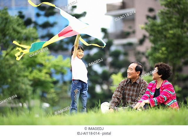 View of a girl playing with kite