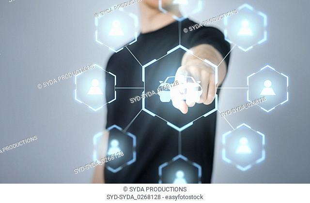 businessman with virual hologram of car sharing