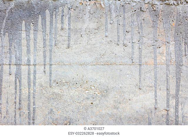 concrete wall with cement drips and copyspace in the middle