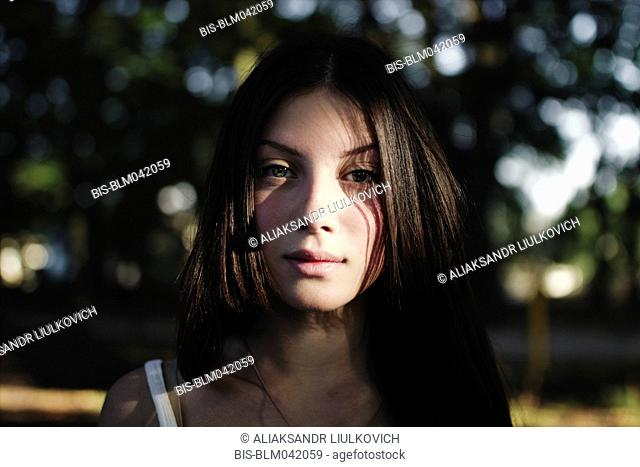 Portrait of serious Caucasian girl outdoors