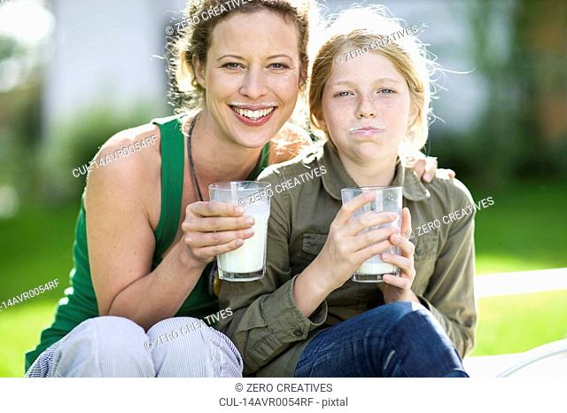 mother and daughter drinking milk