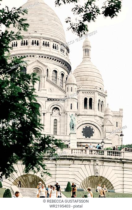 Tourists visiting Basilica of the Sacred Heart of Paris