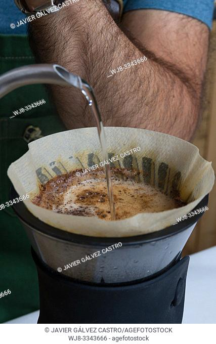 Barista making coffee with filtered