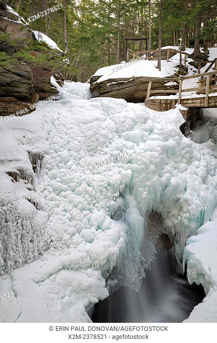 Sabbaday Falls during the winter months. These falls are located off the Kancamagus Highway (route 112) in the White Mountains of New Hampshire USA