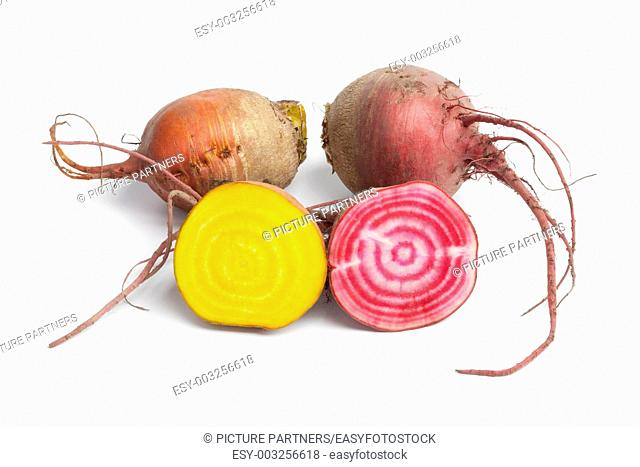 Fresh raw Chioggia beets and yellow beets on white background