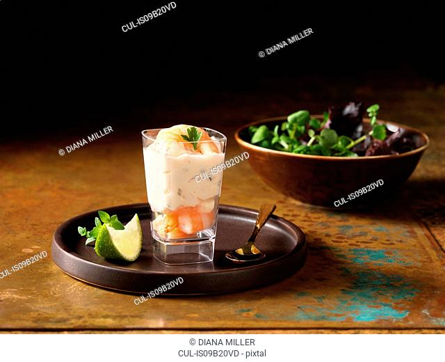 Christmas, celebration food, prawn and salmon appetiser, fresh slice of lime, thyme, salad leaves in bowl