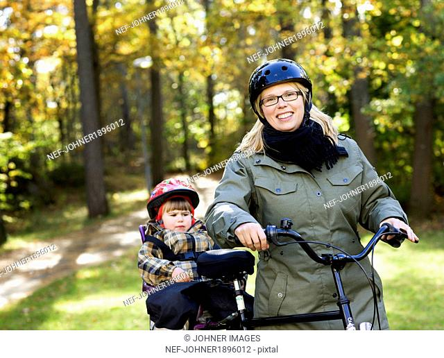 Mather with daughter cycling