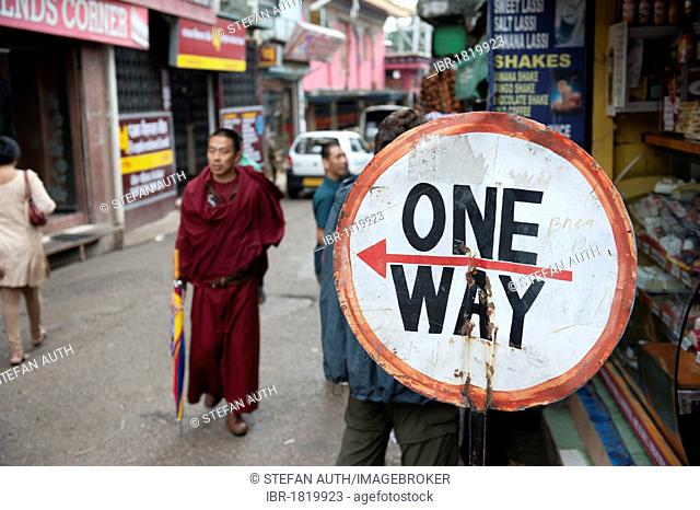 Monk walking in a street next to a one way traffic sign, Tibetan Buddhism, road in Upper Dharamsala, McLeod Ganj, Himachal Pradesh, India, South Asia, Asia
