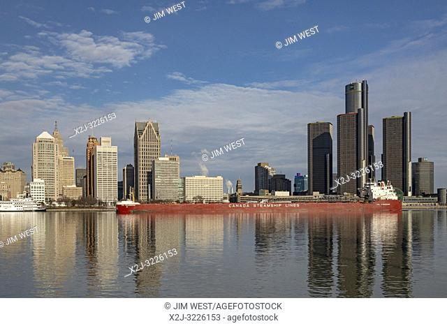 Windsor, Ontario, Canada - The CSL Assiniboine, a bulk cargo carrier, sails downbound on the Detroit River, passing Detroit
