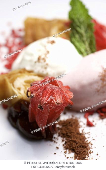 Strawberry ice cream with whipped cream and caramelized flower