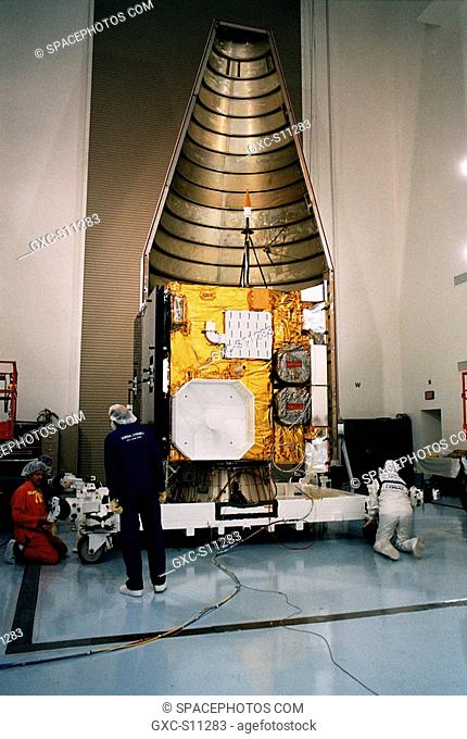 04/09/1997 --- Workers at the Astrotech Space Operations LP facility in Titusville make final checks and adjustments after encapsulating the GOES-K advanced...