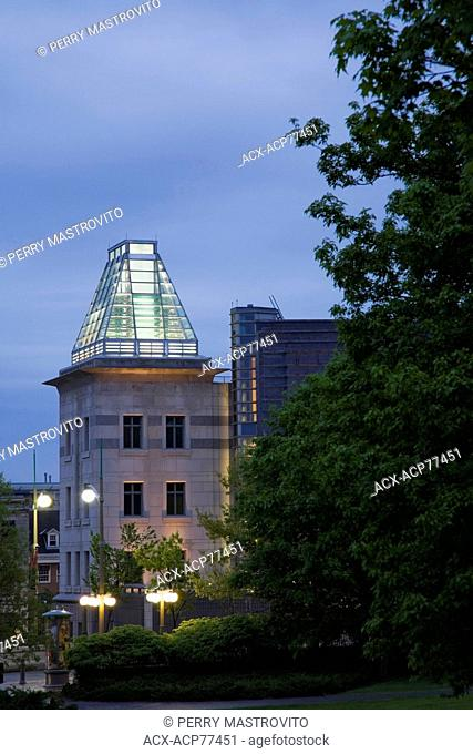 The United States of America (US) embassy building through Major's Hill park at dusk in Ottawa, Ontario, Canada