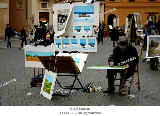Piazza Navona. Square. Street artist. Man sitting. Painting. Paintings displayed for sale. People