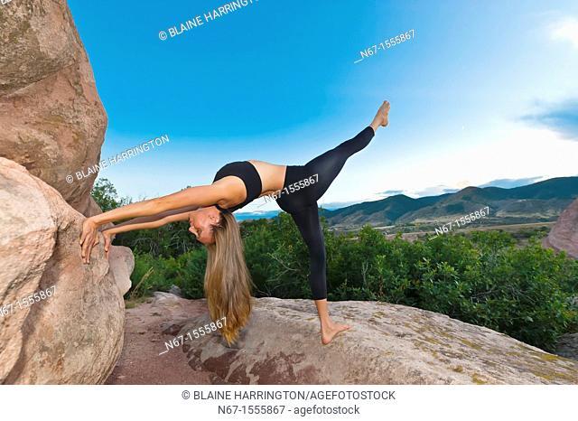 Woman doing yoga, South Valley Park, Littleton, Colorado USA