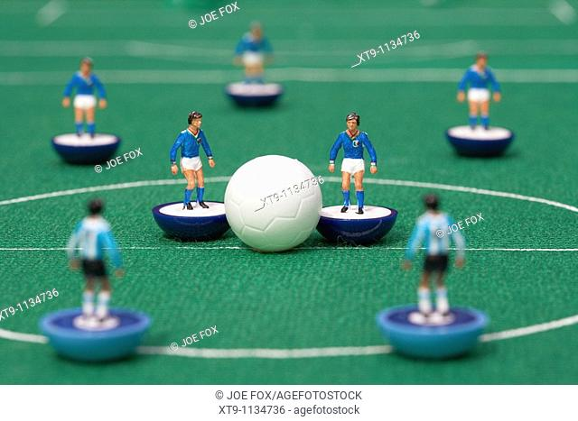 kick off or restart football soccer scene reinacted with subbuteo table top football players game