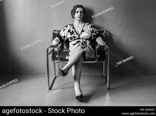 Tilburg, Netherlands. Studio Portrait of an adult, caucasian woman in black and white. Studio Shot on Analog Black & White Film
