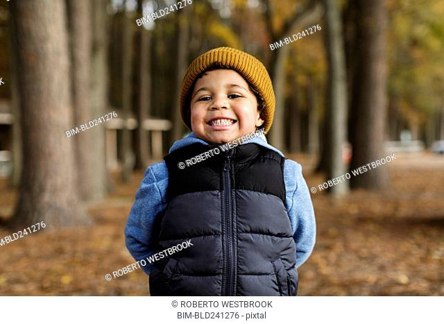 Portrait of smiling Mixed Race boy in park