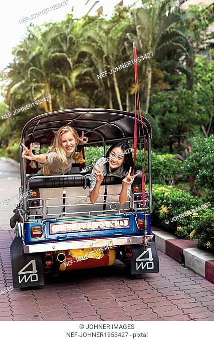 Young women in rickshaw, Bangkok, Thailand