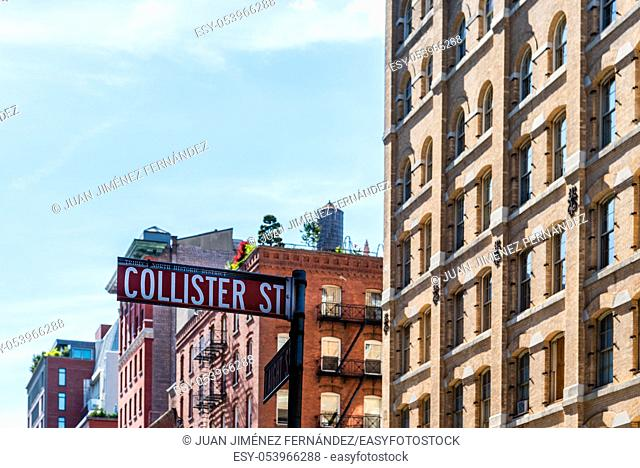 Low angle view of Collister Street name sign against luxury apartment buildings in Tribeca North District of New York City